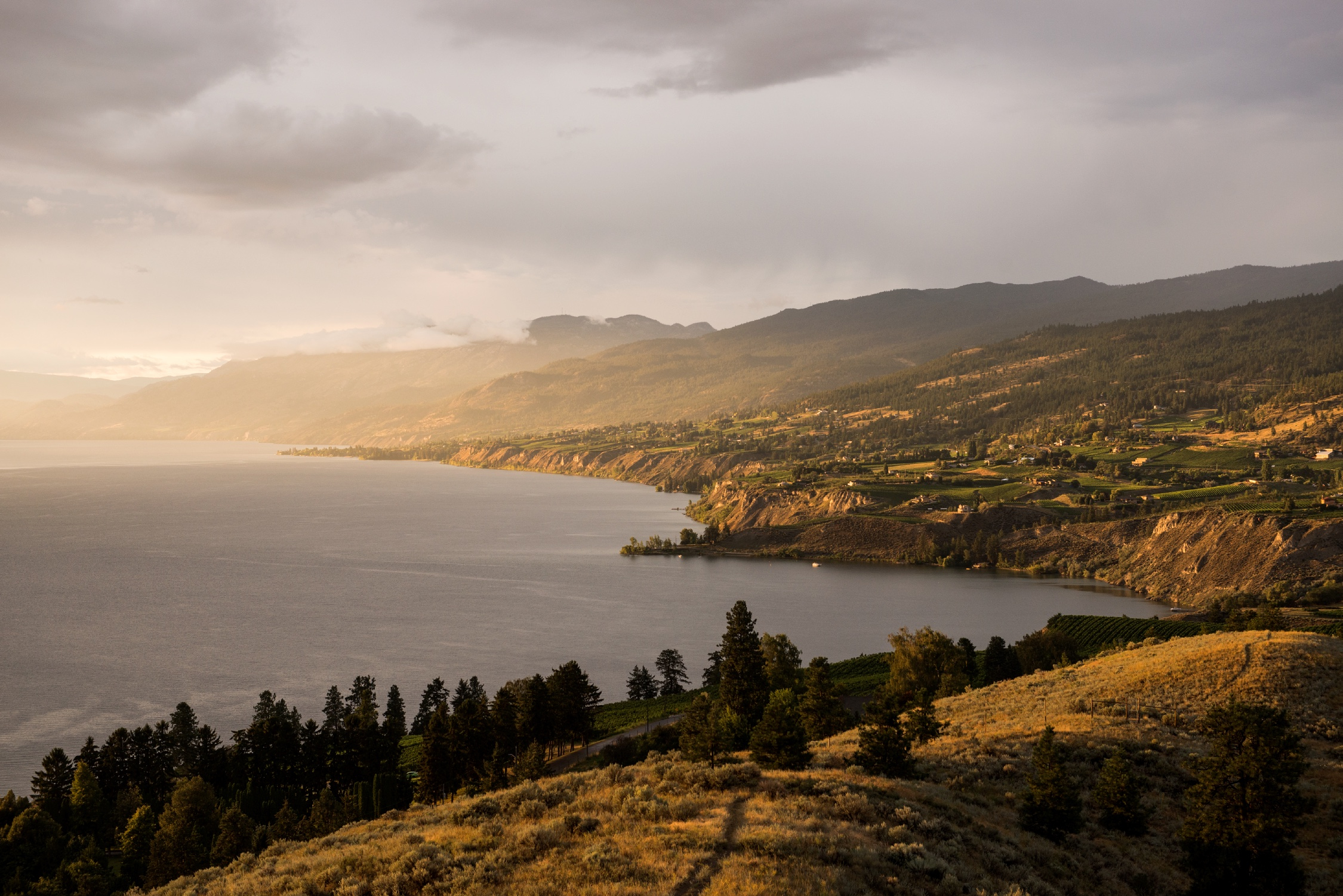 The sunset view of the east side of Okanagan Lake towards Naramata from Munson Mountain, Penticton, BC.