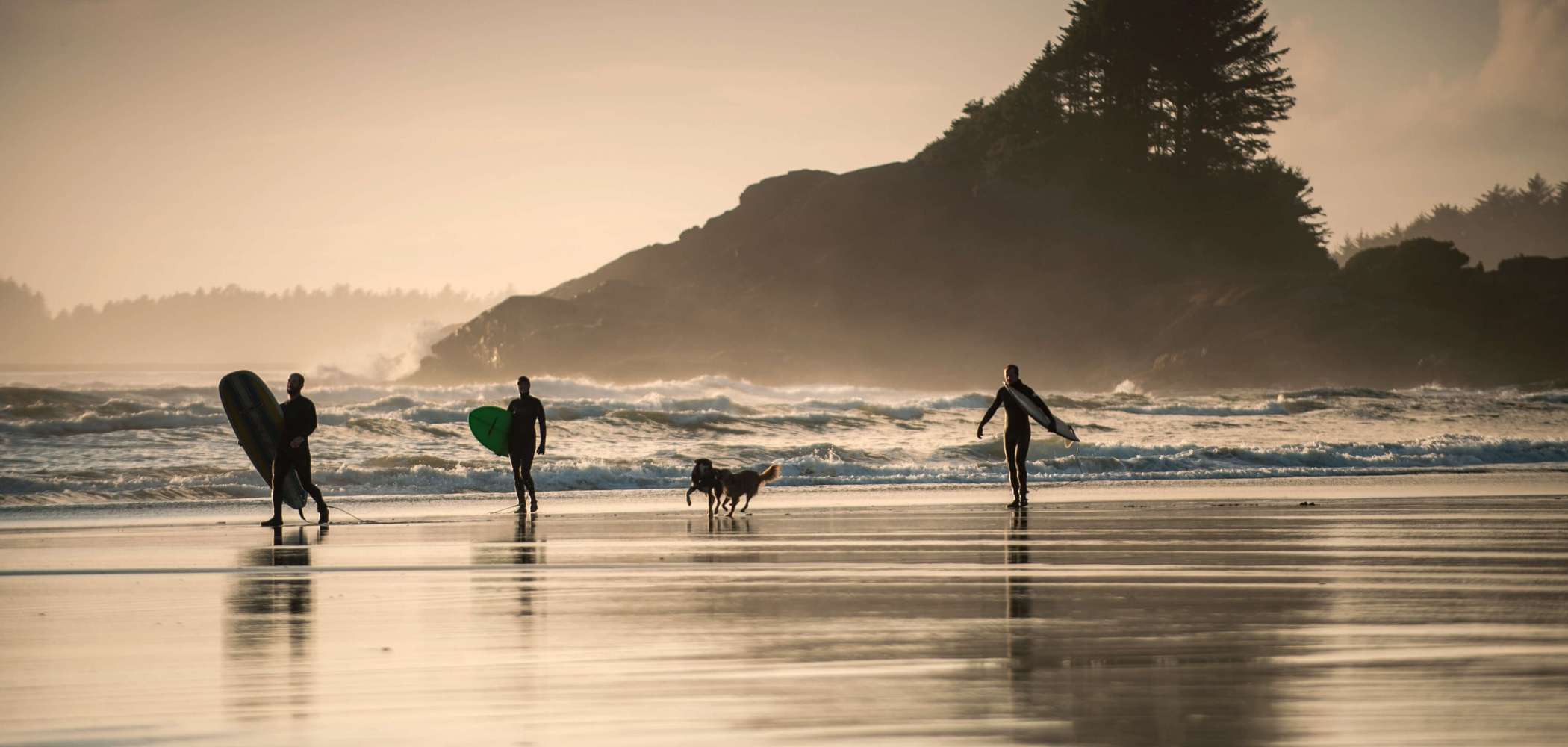 Surfers at Cox Bay on Vancouver Island